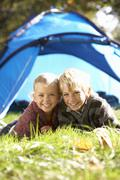 Young children pose outside of tent Stock Photos