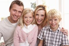 Young family pose together Stock Photos