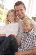 Man and children pose together - stock photo