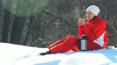 The girl drinks hot tea (coffee) on a frost in the winter Stock Footage