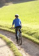 Young woman rides her bike in park Stock Photos