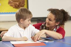 Schoolboy Studying In Classroom With Teacher Stock Photos