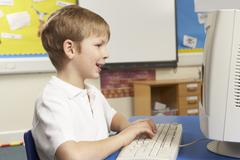 Stock Photo of Schoolboy In IT Class Using Computer
