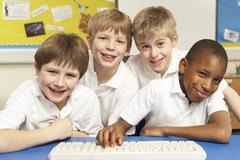 Schoolchildren in IT Class Using Computers - stock photo