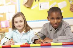 Schoolchildren Studying in classroom - stock photo