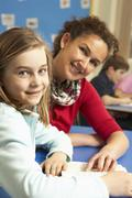 Schoolgirl Studying In Classroom With Teacher Stock Photos
