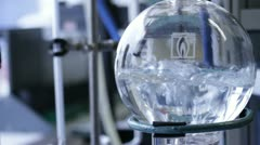 boiling water in chemistry lab - stock footage