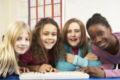 Group Of Schoolgirls In IT Class Using Computer Stock Photos