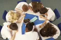 Overhead View Of Schoolchildren Working Together At Desk - stock photo