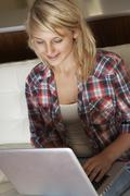 Teenage Girl Using Laptop At Home - stock photo