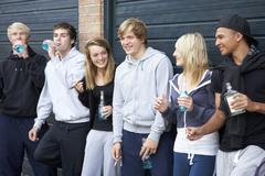 Group Of Teenagers Hanging Out Together Outside Drinking Stock Photos
