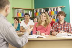 Teenage Students Studying In Classroom With Tutor Stock Photos