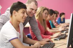 Teenage Students In IT Class Using Computers In Classroom With T Stock Photos