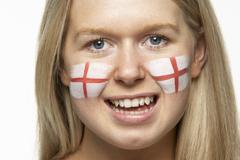 Young Female Sports Fan With St Georges Flag Painted On Face - stock photo