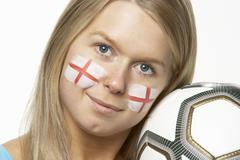 Young Female Football Fan With St Georges Flag Painted On Face - stock photo
