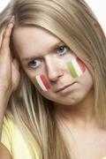 Disappointed Young Female Sports Fan With Italian Flag Painted On Face Stock Photos