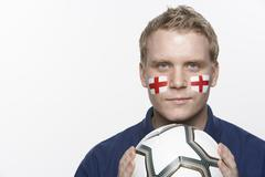 Young Male Football Fan With St Georges Flag Painted On Face - stock photo