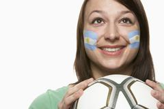 Young Female Football Fan With Argentinian Flag Painted On Face Stock Photos