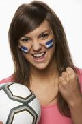 Young Female Football Fan With Honduran Flag Painted On Face - stock photo