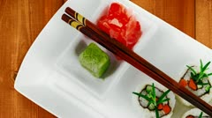 Maki Sushi California Roll made of Raw Salmon Cream Cheese and Vegetables inside Stock Footage