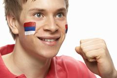 Young Male Football Fan With Serbian Flag Painted On Face Stock Photos