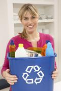 Woman Holding Recyling Waste Bin At Home - stock photo