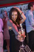 Young Woman Having Fun In Busy Bar Stock Photos