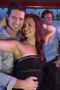 Couple Having Fun In Busy Bar Stock Photos