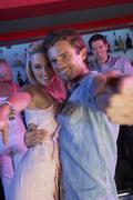 Couple Having Fun In Busy Bar - stock photo