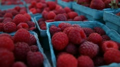 Raspberries and Strawberries at a grower's market Stock Footage