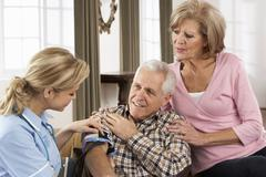 Health Visitor Taking Senior Man's Blood Pressure - stock photo