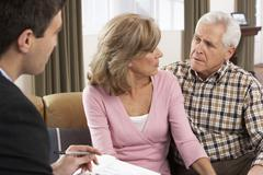 Stock Photo of Senior Couple Talking With Financial Advisor