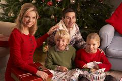 Family Opening Christmas Gifts At Home Stock Photos