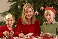Mother And Children Making Christmas Cards Together Stock Photos