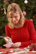 Woman Making Christmas Cards At Home Stock Photos