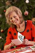 Senior Woman Making Christmas Cards At Home Stock Photos