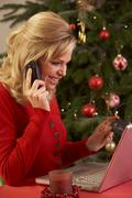 Woman Shopping Online For Christmas Gifts On Phone - stock photo