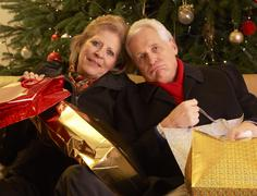 Senior Couple Returning After Christmas Shopping Trip Stock Photos