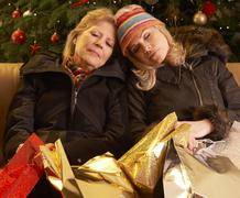 Two Women Returning After Christmas Shopping Trip Stock Photos
