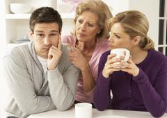 Senior Mother Interferring With Couple Having Argument At Home Stock Photos