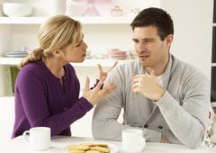 Couple Having Argument At Home Stock Photos
