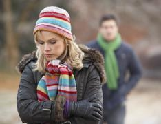 Couple On Romantic Winter Walk Through Frosty Landscape - stock photo