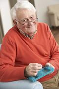 Senior Man Sorting Medication Using Organiser At Home Stock Photos