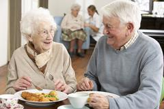 Senior Couple Enjoying Meal Together Stock Photos