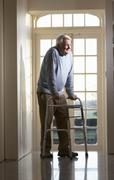 Elderly Senior Man Using Walking Frame - stock photo