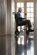 Disabled Senior Man Sitting In Wheelchair - stock photo