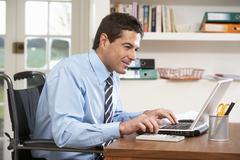 Man Working From Home Using Laptop - stock photo