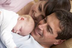 Portrait Of Proud Parents With Newborn Baby At Home - stock photo
