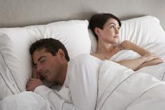 Couple With Problems Having Disagreement In Bed Stock Photos