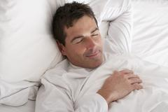 Man Sleeping Peacefully In Bed Stock Photos